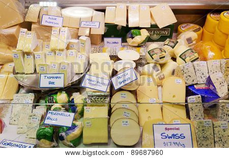 Variety of cheese selling in a market