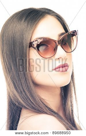 Beautiful young woman posing with sunglasses, isolated on white