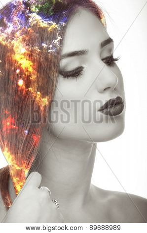 Double exposure photo of nebula and young woman portrait