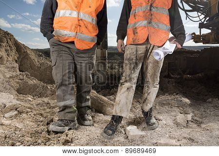 Manual workers at construction site