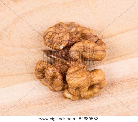 Close up of walnut kernels on wood table.