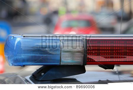 Blue And Red Flashing Sirens Of Police Car