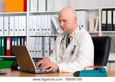 Young Family Doctor In His Office