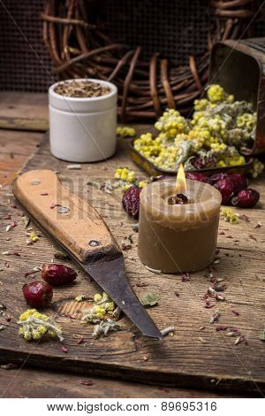 Medicinal Herb And Burning Candle