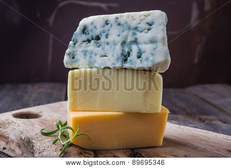 Three Types Of Cheese: Blue Cheese, Mozzarella And Emmental