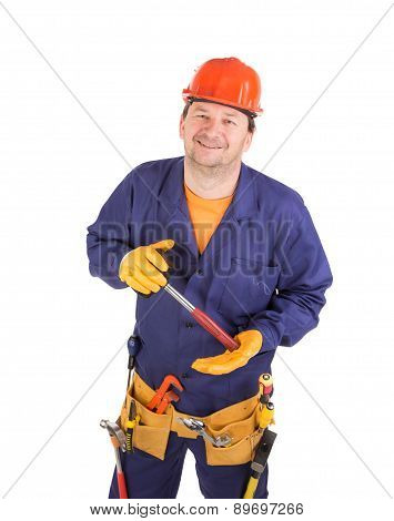 Worker in hard hat holding hammer.