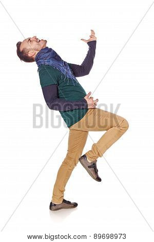 Young man playing air guitar