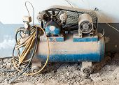 stock photo of air compressor  - Old air compressor for small garage in the countryside - JPG