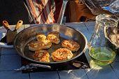 foto of pancake flip  - Traditional raised pancakes frying in a cast iron skillet during the pancake day - JPG