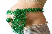 image of tawdry  - Closeup of Pregnant woman belly with christmas decorations - JPG