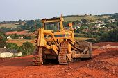 foto of bulldozers  - bulldozer working on a road construction site - JPG