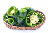 stock photo of pasilla chili  - sliced poblano peppers on bamboo basket on white - JPG