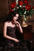 picture of fascinating  - Portrait of  beautiful woman in brown dress - JPG