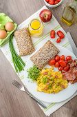 image of scrambled eggs  - Scrambled eggs with bacon chive and tomatoes fresh juice and little microgreens healthy salad - JPG