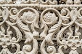 foto of wrought iron  - White painted wrought cast iron decoration with nobody - JPG