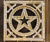 foto of iron star  - Aged soviet Russian Star in wrought iron with flakes and signs of age - JPG