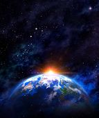 pic of outer  - Imaginary view of planet earth in outer space with the rising sun - JPG