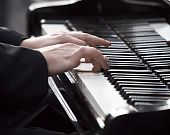 picture of chopin  - Man Pianist playing piano on white and black musical instrument - JPG
