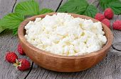 pic of curd  - Curd cheese in wooden bowl on rustic table close up view - JPG