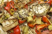 image of leek  - Vegetables mix baked in the oven with aubergine, red bell pepper, leek, basil and olive oil.