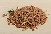 pic of buckwheat  - Raw buckwheat heap on the wood background - JPG