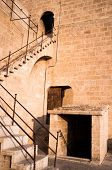 image of bannister  - Detail take of a staircase climbing to the battlements of a castle - JPG