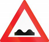 stock photo of bump  - Austrian sign indicating speed bumps or uneven road - JPG