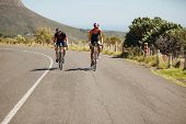 picture of  practices  - Cyclist riding bikes on open road - JPG