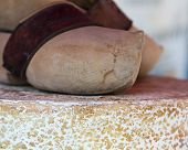 pic of clog  - Clogs top a cheese on display at a French market - JPG