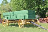 image of wagon  - Historic antique wooden wagon on display for tourists taken in rural Oklahoma - JPG