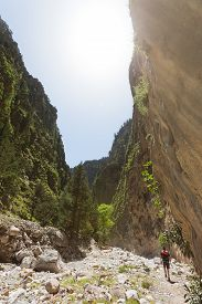 image of samaria  - A man hiking within the Samaria Gorge of Crete - JPG