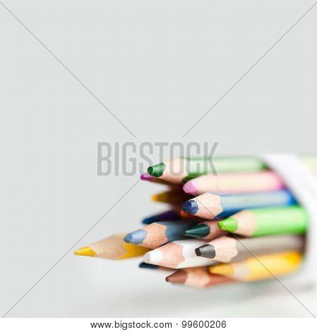 Retro Pencils On The Gray Background.