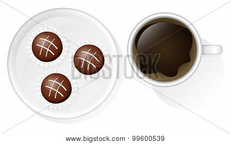 Cup Of Coffee And Three Chocolates On A Saucer