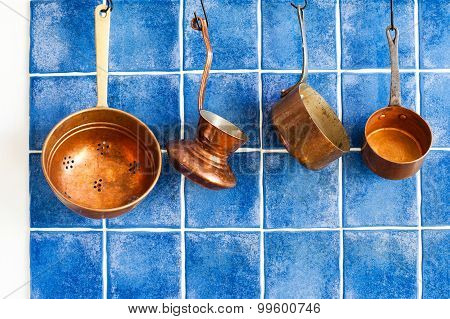 Cooking Utensils. Ancient Copper Cookware, Blue Tiles Wall Background.