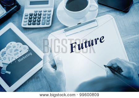 The word future and man writing on clipboard on working desk against digital marketing graphic