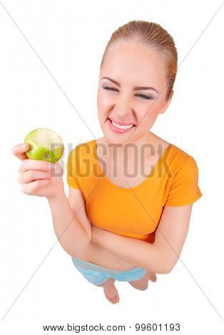 Young funny girl with apple isolated