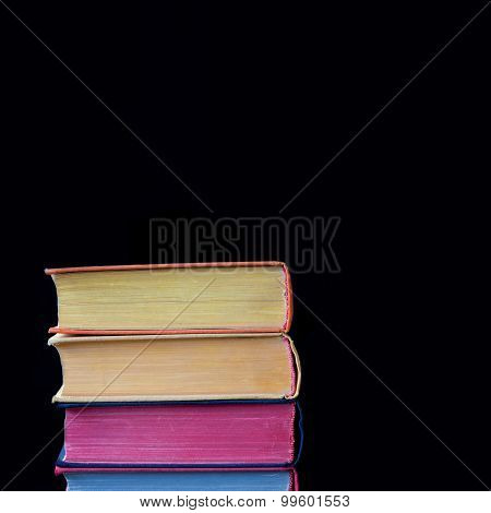 Colorful Book Covers. Black Background. Isolated