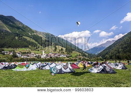 People Enjoy Windsurfing At Lake Levico In Latsch