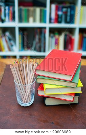 Colored Pencils With Pile Of Books With Colored Covers