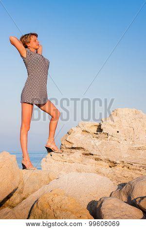 Beatiful woman standing on the rocks