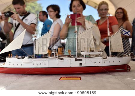 ST. PETERSBURG, RUSSIA - AUGUST 15, 2015: People on the exhibition of the sailing ship models during the International marine festival. The fest is main event of the Great St. Petersburg Sailing Week