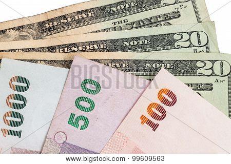 Closeup Of Thai Baht And American Us Dollar