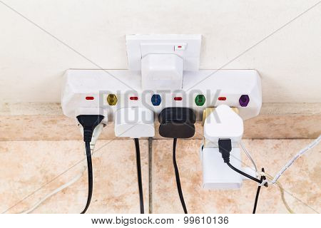 Multiple Electricity Plugs Attached To Multi Adapter Is Dangerous