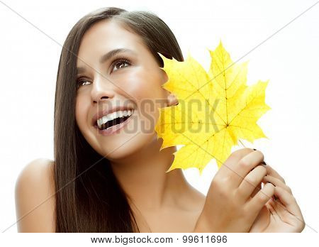portrait of attractive  caucasian smiling woman isolated on white studio shot with yellow autumn leaf