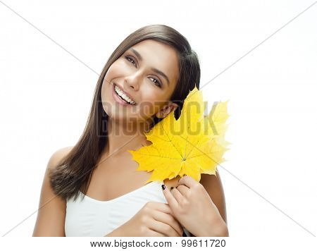 portrait of attractive  caucasian smiling woman isolated on white studio shot with yellow maple autumn leaf