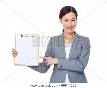 Young businesswoman finger point to clipboard