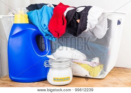 Baking Soda With Detergent And Pile Of Dirty Laundry.