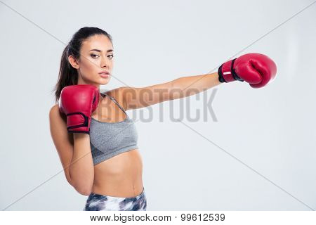 Portrait of a beautiful fitness woman in boxing gloves isolated on a white background