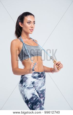 Portrait of a happy sports woman with skipping rope isolated on a white background