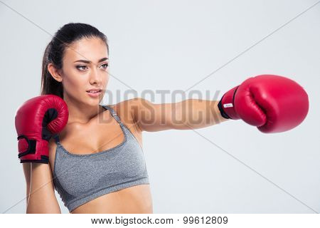 Portrait of fitness woman boxing in gloves isolated on a white background